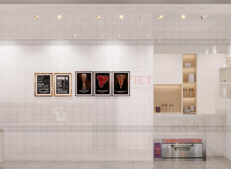 Sử dụng các khung tranh trang trí khiến cho thiết kế tiệm bánh ăn hỏi không đơn điệu
